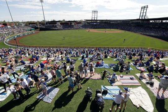 Fans watch the Chicago Cubs play the Milwaukee Brewers during a spring training baseball game Saturday, Feb. 29, 2020, in Mesa, Ariz.
