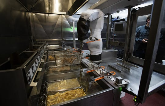 Flippy the robot demonstrates its ability to man a fry station at Miso Robotics  in Pasadena, California.