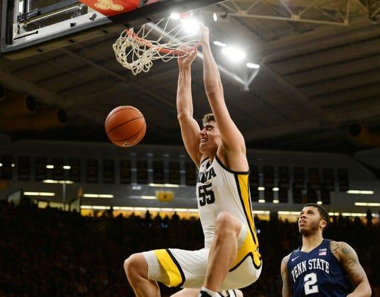 Iowa's Luka Garza (55) dunks in front of Penn State's Myles Dread.
