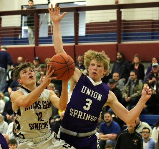 Isaac McIlroy of Watkins Glen drives to the basket as Ryan Bailey of Union Springs defends during the Senecas' 66-38 win in a Section 4 Class C boys basketball quarterfinal Feb. 28, 2020.