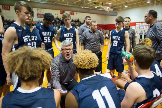Reitz Head Coach Michael Adams  gives direction during a timeout as the Reitz Panthers play the Bosse Bulldogs at Bosse High School Friday evening, Feb. 28, 2020.