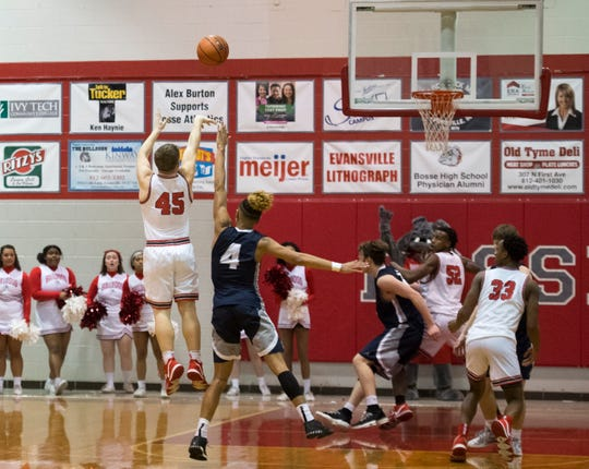 Bosse's Kolten Sanford (45) takes the three-point shot that won the game against the Reitz Panthers as the Bosse Bulldogs play the Reitz Panthers at Bosse High School Friday evening, Feb. 28, 2020. Bosse won 71-70.