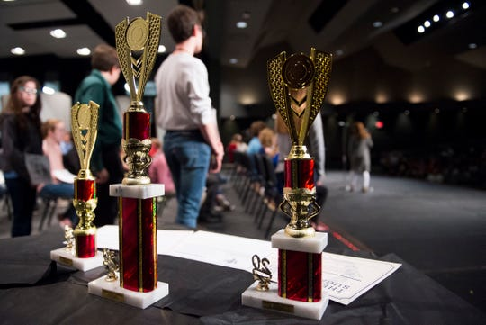 Trophies sit on a table for the top three finishers during 2020 EVSC Regional Spelling Bee at the Academy of Innovative Studies in Evansville, Ind., Saturday afternoon, Feb. 29, 2020.