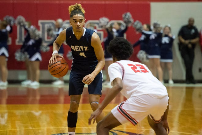 Reitz junior Khristian Lander (4) looks to make a play against Bosse in February.