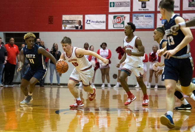 Bosse's Kolten Sanford (45) dribbles the ball as the Bosse Bulldogs play the Reitz Panthers at Bosse High School Friday evening, Feb. 28, 2020. Bosse won 71-70.