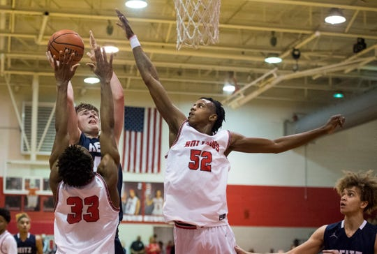 Bosse's Kiyron Powell attempts to block a shot against Reitz in February. The senior was selected to the Indiana All-Star team.