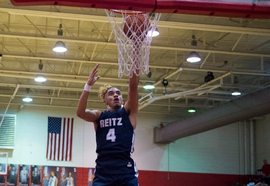 Reitz's Khristian Lander (4) takes a shot as the Reitz Panthers play the Bosse Bulldogs at Bosse High School Friday evening, Feb. 28, 2020
