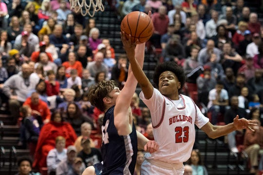 Bosse's Julian Norris (23) takes a shot as the Bosse Bulldogs play the Reitz Panthers at Bosse High School Friday evening, Feb. 28, 2020. Bosse won 71-70.