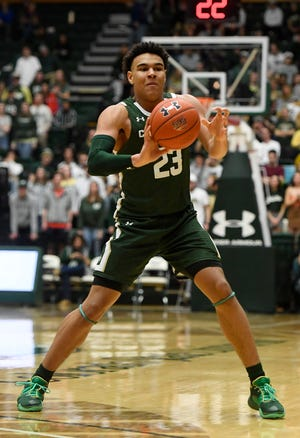 Colorado State Rams guard John Tonje (23) passes the ball to a teammate in the second half of the game at Moby Arena at Colorado State University in Fort Collins, Colo. on Saturday, February 29, 2020.