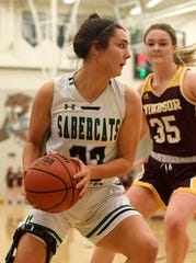 Fossil Ridge basketball player Jazi Barela (33) looks to pass the ball as Windsor's Jackie Jensen (35) defends in the first half of the game at Fossil Ridge High School in Fort Collins, Colo. on Friday, February 28, 2020.