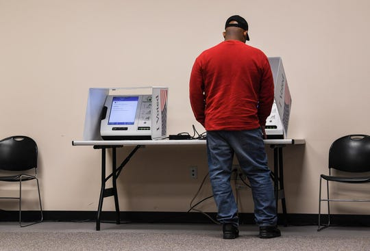 A man votes in Greenville during the South Carolina democratic primary for U.S. President Saturday, February 29, 2020.