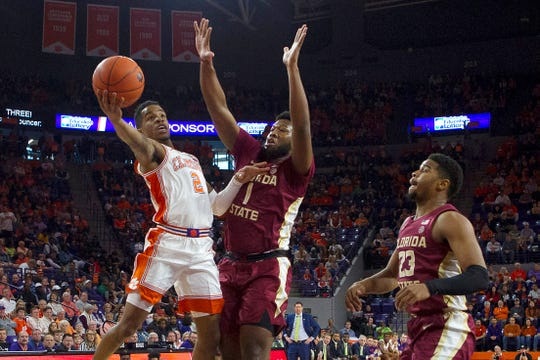 Al-Amir Dawes (2) scored the winning basket in Clemson's upset of Florida State on Saturday.