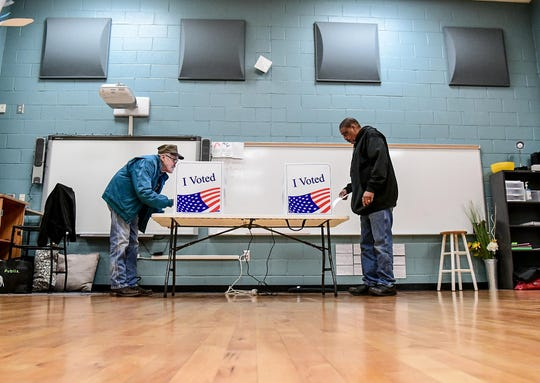 David Dean, left, and Reginald Gilliiard vote at Southwood Academy of the Arts in Anderson during the South Carolina democratic primary for U.S. President Saturday, February 29, 2020.