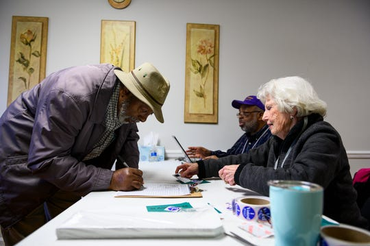 Alexander Whitesides, left, checks in at Charleston Baptist Church before casting his ballot the day of the South Carolina democratic primary Saturday, Feb. 29, 2020.