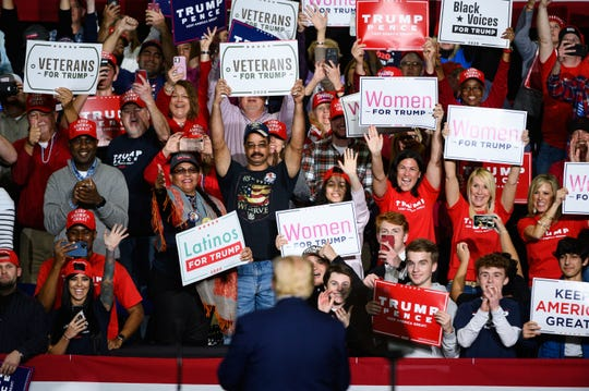 President Donald Trump claps with supporters during a rally at the North Charleston Coliseum Friday, Feb. 28, 2020.