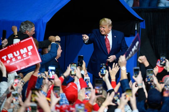 President Donald Trump points to supporters during a rally at the North Charleston Coliseum Friday, Feb. 28, 2020.