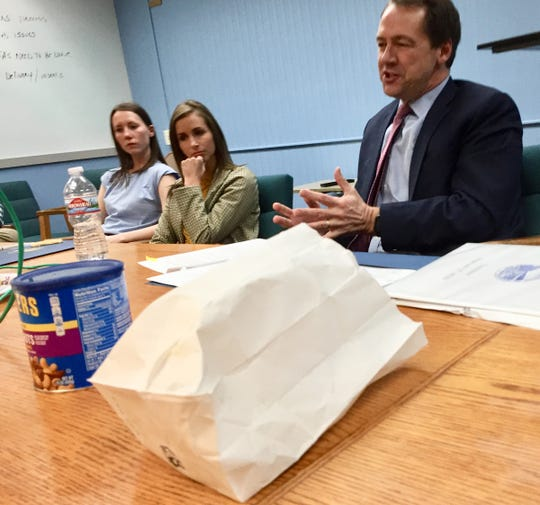 Gov. Steve Bullock and staff visit with Tribune staff Thursday to talk about his last year in office. Cookie coveted by Tribune staff columnist Phil Drake is in white bag, and obnoxious green wire that governor eventually unplugged is to left of peanut can.