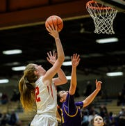 Roy-Winifred's Isabelle Heggem shoots over Hays-Lodgepole's Tahtianna Whitecow-Morgan during the semifinal game of the Northern C Divisional Basketball Tournament in the Four Seasons Arena, Friday.
