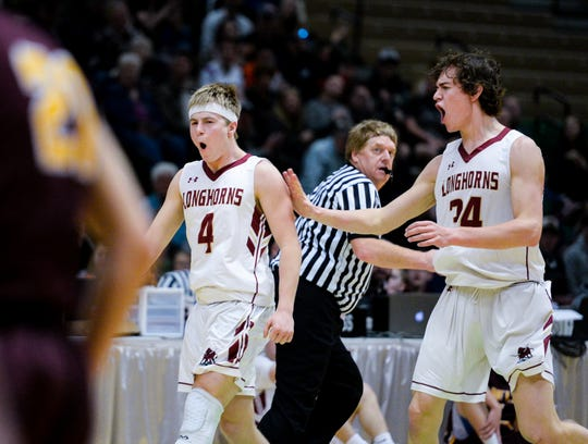 Fort Benton's Jace Thompson, no. 4, celebrates hitting a three point basket with teammate Garett Diekhans during the Northern C Divisional Basketball Tournament semifinal against Belt on Friday in the Four Seasons Arena.