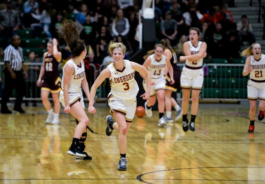 Fort Benton's McKenzie Clark celebrates a buzzer beating three pointer to end the first half during the semifinal game of the Northern C Divisional Basketball Tournament against Belt in the Four Seasons Arena, Friday.