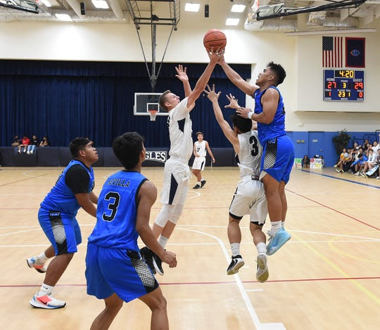 The Saint Paul Warriors play the Harvest Eagles in this Feb. 28 file photo. The Guam Basketball Confederation released the first Guam High School Boys National Championship bracket, which begins March 9.