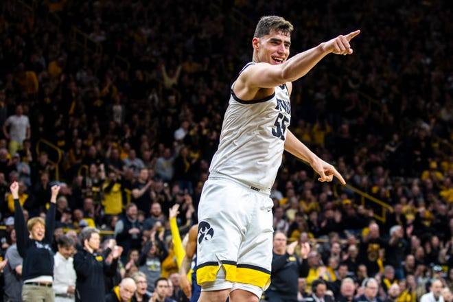 Iowa center Luka Garza (55) points to the bench after making a dunk during a NCAA Big Ten Conference men's basketball game, Saturday, Feb. 29, 2020, at Carver-Hawkeye Arena in Iowa City, Iowa.