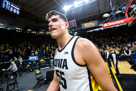 Iowa center Luka Garza (55) walks off the court after a NCAA Big Ten Conference men's basketball game against Penn State, Saturday, Feb. 29, 2020, at Carver-Hawkeye Arena in Iowa City, Iowa.