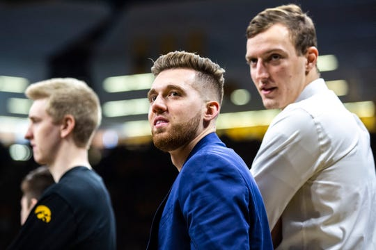 Jordan Bohannon, center, and Jack Nunge got good news from the Big Ten on Tuesday.