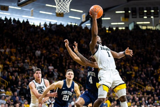 Iowa guard Joe Toussaint (1) makes a layup as Penn State's Curtis Jones Jr. (4) defends during a NCAA Big Ten Conference men's basketball game, Saturday, Feb. 29, 2020, at Carver-Hawkeye Arena in Iowa City, Iowa.
