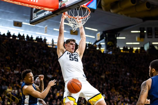 Iowa center Luka Garza (55) dunks during a NCAA Big Ten Conference men's basketball game against Penn State, Saturday, Feb. 29, 2020, at Carver-Hawkeye Arena in Iowa City, Iowa.