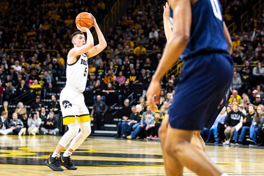 Iowa guard CJ Fredrick (5) makes a 3-point basket during a NCAA Big Ten Conference men's basketball game against Penn State, Saturday, Feb. 29, 2020, at Carver-Hawkeye Arena in Iowa City, Iowa.