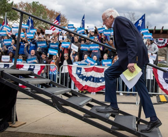 Bernie Sanders approaches a stage to speak during a rally in Columbia, S.C., in advance of the state's Democratic primary on Saturday.