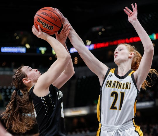 Loogootee Lions Kylie VanHoy attempts a layup against Pioneer Panthers Madison Blickenstaff during the IHSAA Class A Girls Basketball State at Bankers Life Fieldhouse, Indianapolis, Saturday, Feb., 29, 2020.