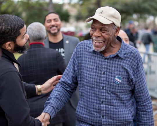 Actor Danny Glover shakes hands with Jackson Mayor Chokwe Lumumba after speaking during a Bernie Sanders rally in Columbia, S.C., in advance of the state's primary, Friday, Feb. 28, 2020. Glover and Lumumba, along with activist Phillip Agnew, are stumping this weekend in Mississippi for Sanders ahead of Tuesday's primary.