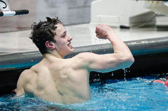 Delta swimmer Braden Samuels looks at his time and celebrates during the IHSAA Boys Swimming and Diving State Championship Meet at the IU Natatorium at IUPUI, Indianapolis, Friday, Feb. 28, 2020. Swimmers that advanced from trials will compete in the finals Saturday, Feb., 29, 2020.