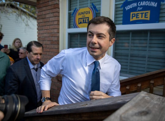 Pete Buttigieg walks up stairs after greeting and thanking volunteers on the day of the democratic primary in South Carolina, Columbia, Saturday, Feb. 29, 2020. The residence is lived in by a Buttigieg supporter who is the grandson of Jim Clyburn, the House Majority Whip who has endorsed one of Buttigieg's rivals, Joe Biden.