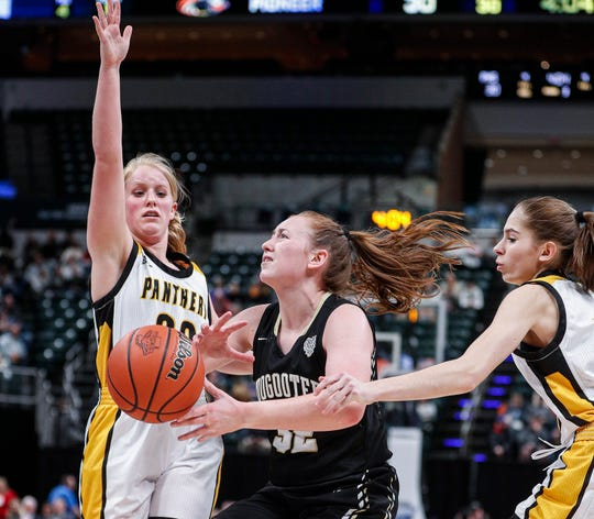 Loogootee Lions Makenzie VanHoy attempts a layup against Pioneer Panthers Mackenzie Walker during the IHSAA Class A Girls Basketball State at Bankers Life Fieldhouse, Indianapolis, Saturday, Feb., 29, 2020.