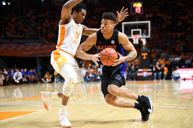 Tennessee's Yves Pons (35) defends against Florida's Keyontae Johnson (11) during a Southeastern Conference game Feb. 29 at Thompson-Boling Arena in Knoxville, Tenn.