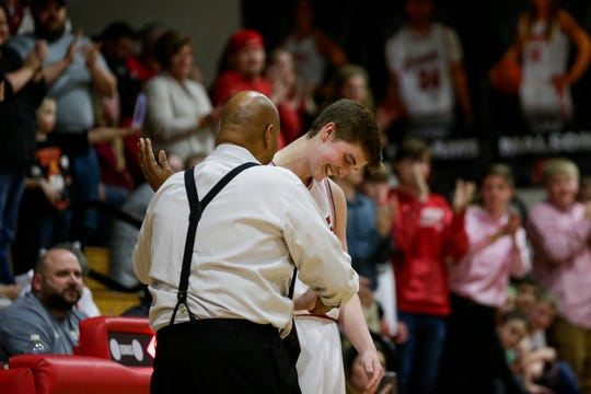 Rossville's Grover Said (31) and West Lafayette head coach David Wood embrace during the first quarter of an IHSAA boys basketball game, Friday, Feb. 28, 2020 in Rossville.