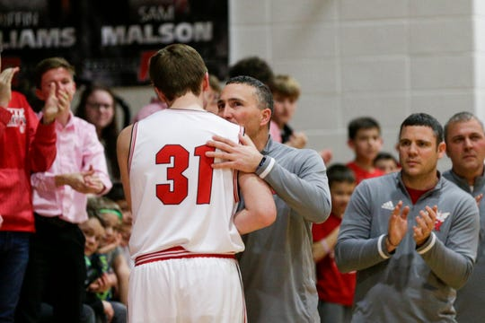 Rossville's Grover Said (31) and Rossville head coach Cory Dunn embrace during the first quarter of an IHSAA boys basketball game, Friday, Feb. 28, 2020 in Rossville.