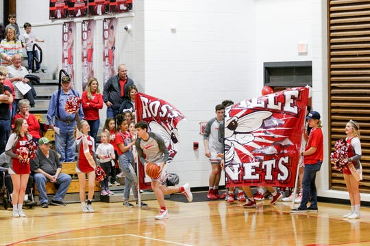 Rossville players take the court before the first quarter of an IHSAA boys basketball game, Friday, Feb. 28, 2020 in Rossville.