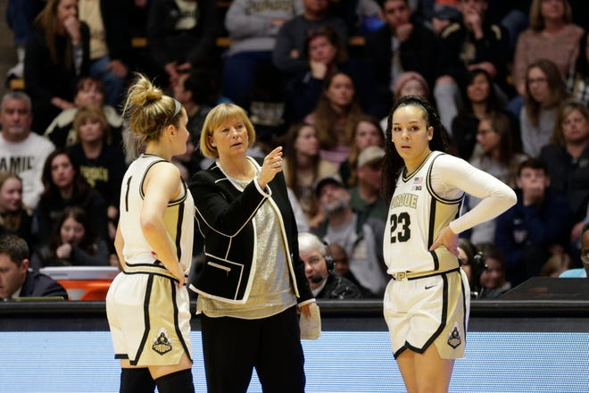 Purdue head coach Sharon Versyp talks with Purdue guard Karissa McLaughlin (1) and Purdue guard Kayana Traylor (23) during the second quarter of a NCAA women's basketball game, Saturday, Feb. 29, 2020 at Mackey Arena in West Lafayette.