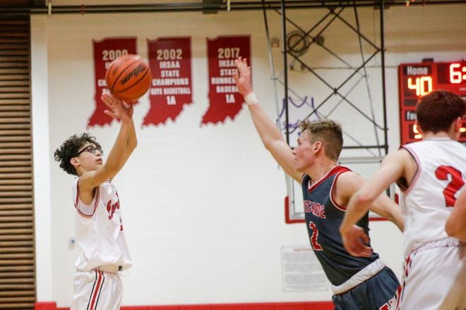 Rossville's Kaden Del Real (14) shoots during the fourth quarter of an IHSAA boys basketball game, Friday, Feb. 28, 2020 in Rossville.