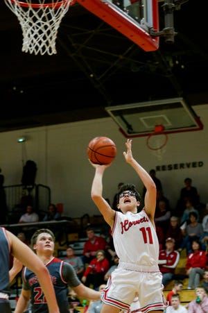 Rossville's Luke Meek (11) goes up for a layup during the fourth quarter of an IHSAA boys basketball game, Friday, Feb. 28, 2020 in Rossville.