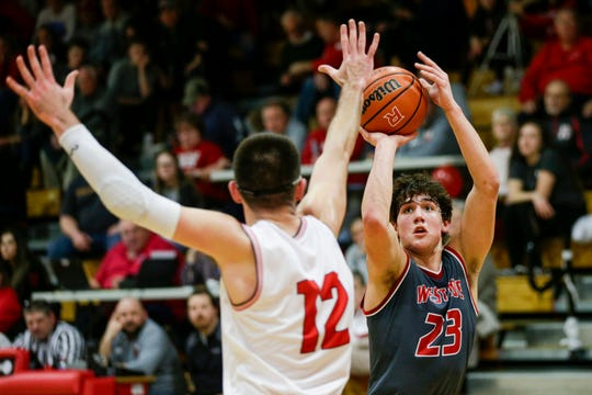 West Lafayette forward Yanni Karlaftis (23) shoots over Rossville's Dirk Shaw (12) during the second quarter of an IHSAA boys basketball game, Friday, Feb. 28, 2020 in Rossville.