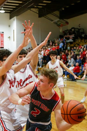 West Lafayette guard Tyler Boyle (2) is guarded by Rossville's Luke Meek (11) and Rossville's Evan Price (25) during the third quarter of an IHSAA boys basketball game, Friday, Feb. 28, 2020 in Rossville.
