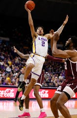 Feb 29, 2020; Baton Rouge, Louisiana, USA; LSU Tigers forward Trendon Watford (2) drives to the basket against Texas A&M Aggies forward Josh Nebo (32) at Maravich Assembly Center. Mandatory Credit: Stephen Lew-USA TODAY Sports
