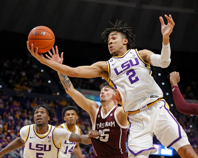 Feb 29, 2020; Baton Rouge, Louisiana, USA; LSU Tigers forward Trendon Watford (2) grabs a rebound from Texas A&M Aggies forward Yavuz Gultekin (35) during the second half at Maravich Assembly Center. Mandatory Credit: Stephen Lew-USA TODAY Sports