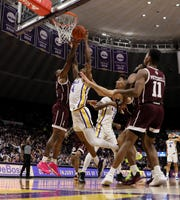 Feb 29, 2020; Baton Rouge, Louisiana, USA;  LSU Tigers guard Skylar Mays (4) goes for a rebound against Texas A&M Aggies guard Wendell Mitchell (11) in the first half at Maravich Assembly Center. Mandatory Credit: Stephen Lew-USA TODAY Sports