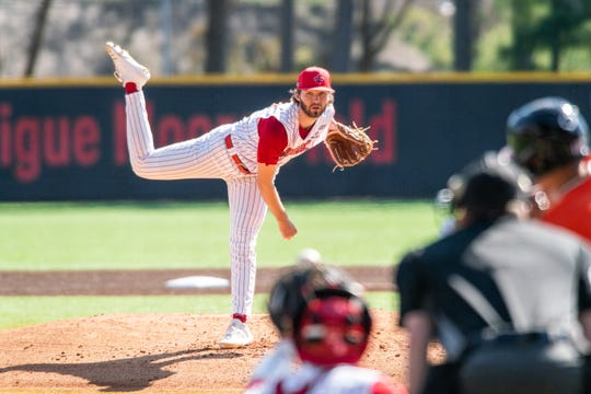 "UL's pitcher Brandon Young watches the ball after throwing to the batter as the Ragin' Cajuns take down the Sam Houston State BearKats 1-0 at M.L. Tigue ""Moore"" Field on Saturday, Feb. 29, 2020."